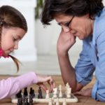Mother And Daughter Playing Chess